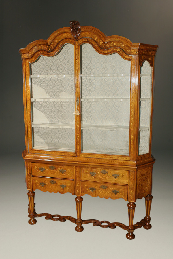 Rare Early 19th Century Dutch Marquetry Inlaid Vitrine The upper cabinet has glass on four sides and includes a fabric backing. The ornamented center piece is typical of Dutch style.