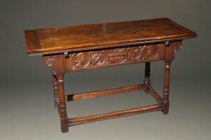Custom English Jacobean style side draw leaf table in oak.